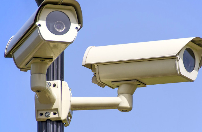 Multiple CCTV cameras posted on a pole.
