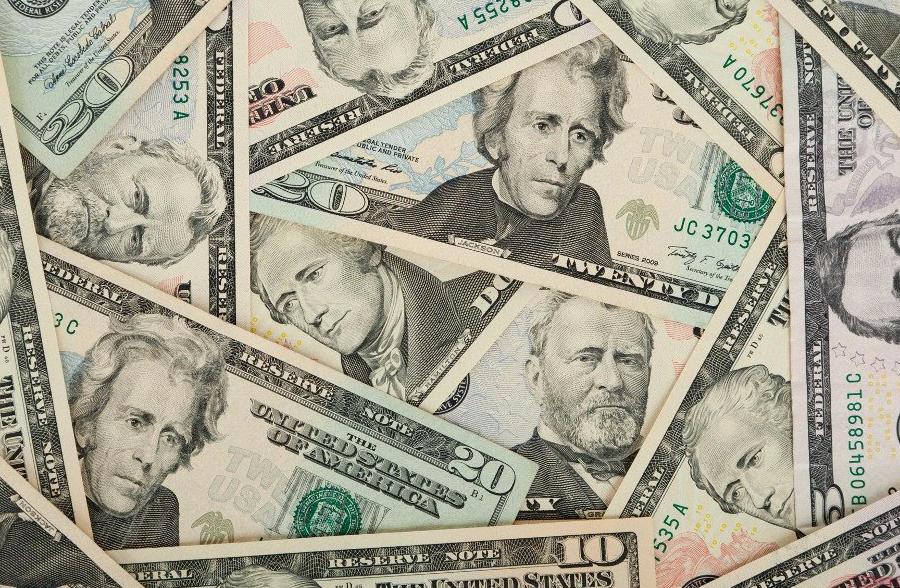 Twenty dollar bills in a pile