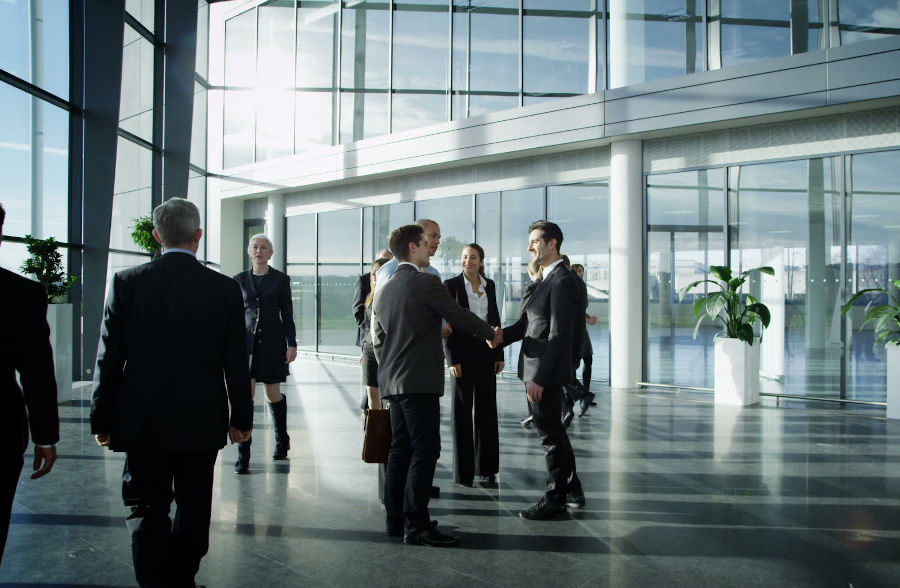 People meeting in a lobby. Preparing to do business.