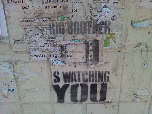 Faded grafiti that says Big Brother is watching you. In reference to internet of things data collection